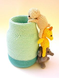 This adorable crochet pen holder would add a funny touch to your desk organization. It's made with a mason jar, covered with a crocheted jar cozy and three little amigurumi animals: an elephant who su