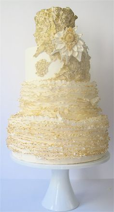 Gold and white cake created by Maggie Austin