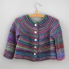 """Best 12 This colorful cardigan is knitted top-down in garter stitch. The seamless yoke is formed by some increase rows. The body is worked in rows, sleeves are worked in the round. The cardigan has a modern, swinging silhouette. The Noro yarn """"Silk Garden Toddler Cardigan, Knitted Baby Cardigan, Cardigan Pattern, Knitting For Kids, Baby Knitting Patterns, Knitting Projects, Top Down, Garter Stitch, Toddler Girl Outfits"""