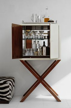 A chic bar cabinet reveals the makings of cocktail hour, by Ralph Lauren Home.