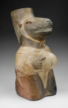 Moche Vessel in the Form of a Seal Impersonator Playing a Drum | The Art Institute of Chicago, Online Collection