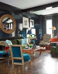 """In a Manhattan apartment designed for a couple in the fashion world, Miles Redd lacquered walls in Farrow & Ball's Hague Blue, """"a great way to do a moody color because of the way it reflects light. It doesn't look dark so much as rich."""" The confident mix of chairs includes graceful Maison Jansen slipper chairs from John Norwood Antiques, upholstered in Velours de Soie Uni in Bleu de France from Prelle."""