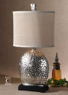 Harrison silver lamp    This lamp is constructed of small, nickel plated squares with a matching finial and a matte black base. The oval drum shade is heavily pleated, ivory linen textile.    Designer:Billy Moon  Wattage:100W  Number of Bulbs:1  Dimensions:30 H Shade 15 W X 10 D (in)  Weight (lbs):9  Ship Via UPS:Yes