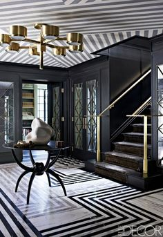 Kelly Wearstler black entrance hall. More pics on my blog about how to use black in your house and in your wardrobe.