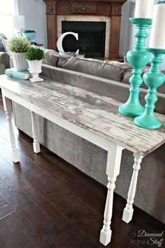 Make your own sofa table using salvaged wood and wooden spindles for a table with charming personality.