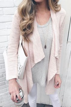 spring transition outfit with pink drape cardigan and white skinny jeans