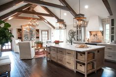 The beams in this main living area make the kitchen and family room really feel like one cohesive space.