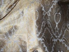 Brocade Fabric, indian brocade, Banaras silk, Silk Brocade Fabric. This is a beautiful pure heavy benarse silk brocade floral design fabric in Off white and Gold. The fabric illustrate golden woven...