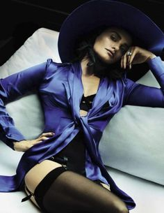 Posing in bed, actress Penelope Cruz wears a seductive lingerie look