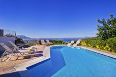 Villa Nikos is a double-decked luxurious villa of 178 m2, in which 6 visitors can have a pleasant, comfortable andcomplete stay. It is built on a hill side and it has a panoramic view to the sea and the mountains. It has a 35sqm private pool