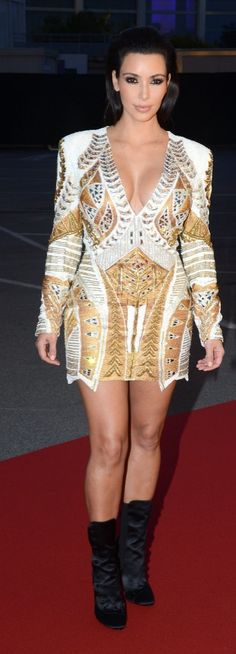 Kim dazzled in a sexy golden Balmain minidress at the 2012 Cannes Film Festival that showed off all of her best assets.