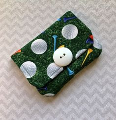 A personal favorite from my Etsy shop https://www.etsy.com/listing/584531343/credit-card-holder-golf-ball-fabric-gift