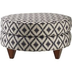 Round style with top cushion and short angular legs.  Nails can be added to bottom section