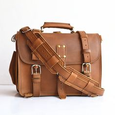 This handmade bag features a 100% full grain leather body and straps that will develop a gorgeous patina as it ages. With a slightly more rotund