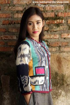 batik amarillis's parisian walkways jacket www.batikamarilli... .. add polish to your tailored wardrobe! such fitted and chic jacket with quirky twist! accented with panelled detailing & contrast trims plus 3 quirky pockets! in such lovely ikat  of Indonesia