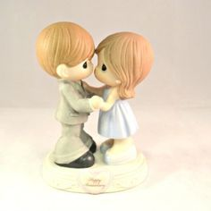 Through the years Precious Moments Figurine:  The happiest couples are those that find new things to love about each other with each passing year. Celebrate any anniversary, whether a first or 60th with this piece showing a couple still in step with one another. Bisque porcelain figurine. 5 1/2″ H.