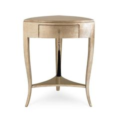 "Tres, Tres Chic : Allow us to ""one up"" ourselves with this variation of our bestselling Tres Chic accent table. The newest option is dressed to the nines in our signature Pompeii gold metallic finish – beloved by our interior designer customers for its beautiful blending of silver leaf and a soft wash of metallic gold. It's like jewelry for your home – a definitive design element for those settings when only ultra glam will do."