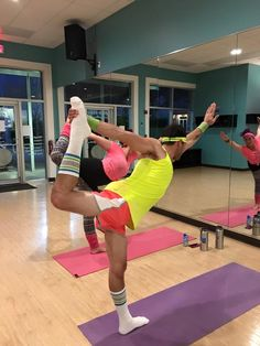 Standing floor bow pose at Hot Yoga 4 U SRQ 80's party. If I have to dress up in a ridiculous Richard Simmons costume to encourage more men to try hot yoga, then that is exactly what I will do! #yoga #yogaposes https://plus.google.com/+MichaelTamezTransformativeNutrition/posts/An87x5sHsnZ
