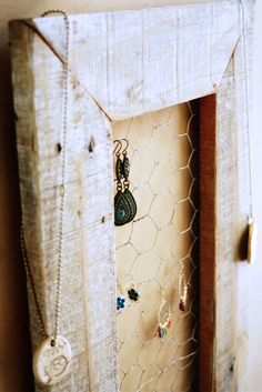 My boss is creating these amazing pieces for jewelry with old window frames and screens. She cuts the screen out of its frame and staples it to the back of refurbished window frames. Such a great idea and it looks awesome! You can do the same with mirrors glued to the back of window frames as well.