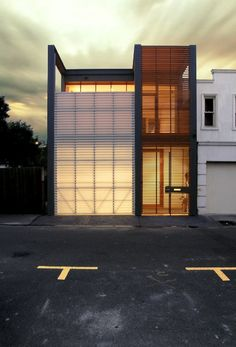 *** lit facade with polycarbonate panels & wooden slat screen walls