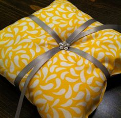 DIY Ring Bearer Pillow - I could do this. Now to decide if we are going to have a ring bearer and flower girl.....