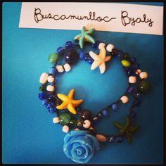 Pulsera de ganchillo con perltas, estrellas, flor y botón Byaly