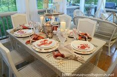 Dining With The Seagulls   http://betweennapsontheporch.net/nautical-table-setting-tablescape-with-lobster-crab-plates-and-fishnet-tablecloth/