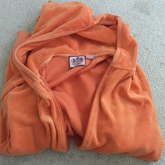 Cute Velour Juicy sweatshirt Orange juicy couture sweater hasn't been worn. XL but fits like a small sizes don't differ in this brand Juicy Couture Sweaters