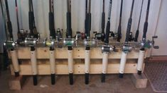 Fishing rod holder / stand - pvc and scrap lumber. There's a photo on the forum without the rods, to see better how it was put together. (How To Build A Shed Dads) Fishing Pole Storage, Fishing Pole Holder, Pole Holders, Fishing Poles, Fly Fishing, Catfish Fishing, Fishing Tackle, Garage Storage, Diy Storage
