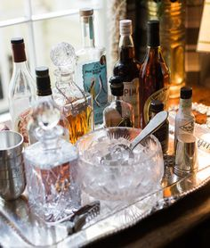 Classic tabletop home bar setup with crystal decanters and ice bowl on traditional silver tray. Any person can produce a house sweet house, . Home Bar Setup, Home Bar Decor, Bar Cart Decor, Bar Antique, Vintage Bar, Serving Cart On Wheels, Cafe Bar, Ice Bowl, Drinks Tray
