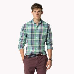 Tommy Hilfiger Aiden check shirt. A preppy plaid frames this fitted style staple. Crafted from crisp poplin cotton with details that set you apart.