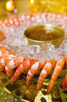 A cocktail ring of beautiful fresh poached shrimp is served with a chilled dipping sauce.