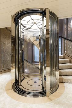 Studio Indigo - M.Y JOY Yacht shortlisted for World Superyacht Award 2017. #Feadship #Studioindigo #yachts #yachting #superyachts #interiors #design #gangway #light #lift #elevator #decoration #wood  #glass #staircase #luxury #details