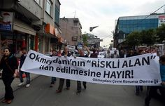 """People march to protest the """"risk zone"""" desicion. DHA Photo"""