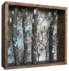 This reminds me of a quirky lamp my grandmother had. It seems to be a lot more successful as a wall piece, however! I want to do this with butterflies instead of birds.