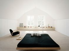 bedrooms-black-light-wood-white-beds-vaulted-ceilings-lounge-chairs-open-shelving-sheets