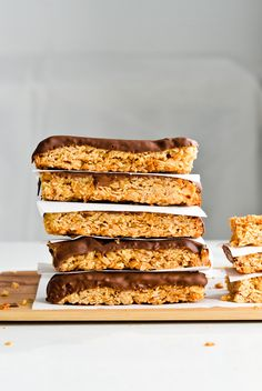 A recipe for easy homemade chocolate dipped coconut peanut granola bars, sweetened only with honey! A batch lasts all week long.