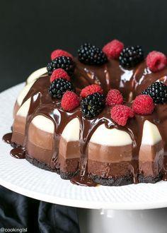 No Bake Three Chocolate Cake Recipe - made in a bundt pan, layers of white, milk and dark chocolate and Oreo cookie crust.