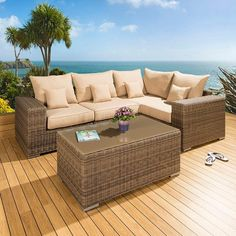 Luxury outdoor garden 5 piece sofa set/settee mocha rattan/beige cushions 2. Truly stunning in design, this large L shape sofa gives a super high-class feel. This set consists of left and right hand end pieces, 2 middle sofa pieces, rectangular glass topped coffee table, clips to hold the pieces together, 4 x scatter cushions and heavy-duty covers in green. Call 02476 642139 or email sales@quatropi.com or visit www.quatropi.com for additional information.