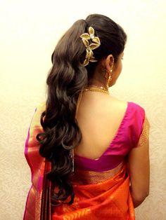 Indian bride's bridal hairstyle by Swank Studio. Find us at https://www.facebook.com/SwankStudioBangalore  #Saree #Blouse #Design
