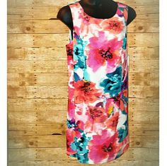 "1 HR SALE NWT Eliza J 16W Floral Sheath Dress 1 HOUR SALE! Stunningly beautiful Eliza J Floral Sheath dress. Brand new with tags. This is an absolutely gorgeous abstract floral design with faux jeweled accents in the center of many of the flowers for a little extra sparkle. Polyester. Dry clean. Lined. Multi-colored. I see shades a pink, orange, Coral, green, blue, black and cream beautifully Blended together. Approximate flat measurements-bust 23"", waist 22.5, length 39"". 16W. Flat lay is…"