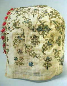 Linen cap with silk and metal embroidery and glass beads, Venetian ca. 1500-1525 (The Met, New York)  Woman's Cap, Venice, 1500–1525, linen, silk, metal thread, glass beads, 9 x 7 3/4 in. The Metropolitan Museum of Art, New York, Rogers Fund, 1916.  Color image shared by Louise Pass on Facebook Historic Hand Embroidery group. Retrieved September 25, 2011 from the http://www.facebook.com/photo.php?fbid=2159223897493&set=o.156337781110182&type=3&theater    From Kimiko Small