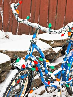 We love this unexpected Christmastime bike. More holiday decor using what you already have: http://www.bhg.com/christmas/indoor-decorating/christmas-decorating-using-what-you-have/?socsrc=bhgpin110612christmasbike#page=15