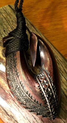 Ti Stained Cattle Bone Hook Matau carving by Master Carver Beau Rasmussen, Sāmoa.
