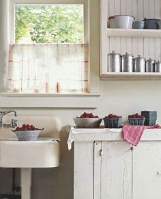 this picture gives me a cozy feeling...love the country kitchen and strawberries ready to make some jam!