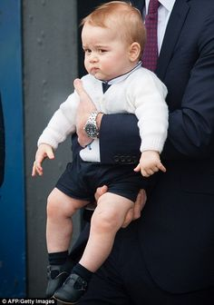 Best dressed boy: Baby Prince George was dressed impeccably the whole trip and was seen he... http://dailym.ai/1f9PDob#i-a9240e6c