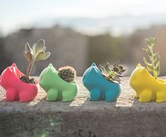 Give your garden or desk a geeky touch your inner child would approve of using these 3D printed Bulbasaur planters. They're available in a variety of spirited colors and feature an open back with just enough room for you to place a tiny plant.