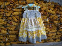 girls apron knot dress yellow and gray, available to order 2T, 3T,4T,5t. $38.00, via Etsy.