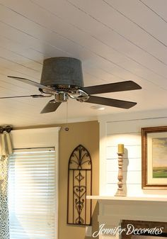We used an old bucket to house the ceiling fan motor.  More Wood Ceiling Ideas from Jennifer Decorates.com