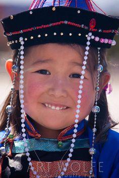 **Mongolian girl in traditional dress, Mongolia | © Art Wolfe